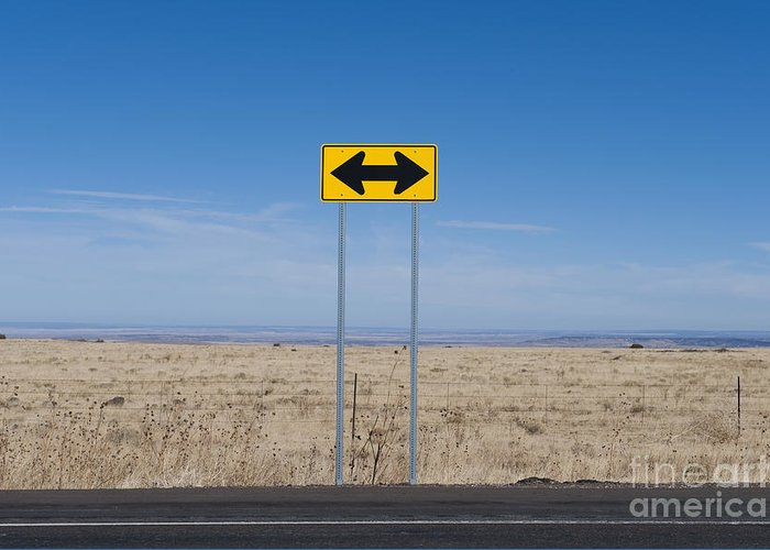 Arid Greeting Card featuring the photograph Road Sign In The Desert by Dave & Les Jacobs