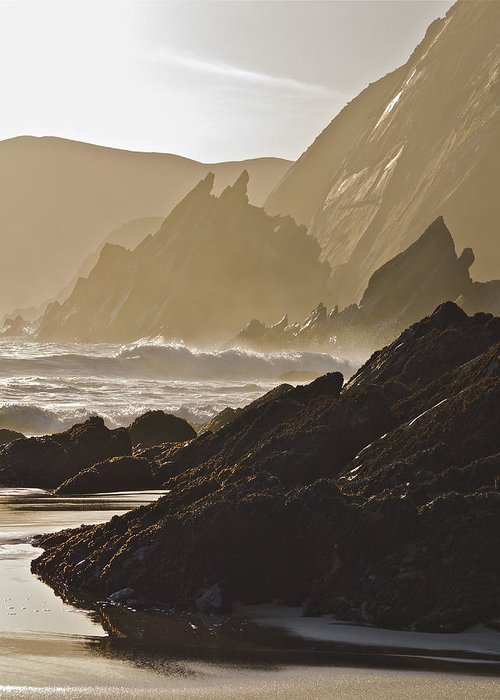 Seascape Greeting Card featuring the photograph Rock And Waves Dingle Peninsular by Julian Easten