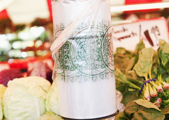 Bag Greeting Card featuring the photograph Roll Of Plastic Produce Bags In A Market by Jetta Productions, Inc