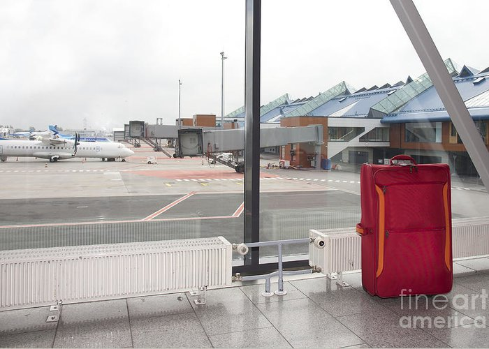 Abandoned Greeting Card featuring the photograph Rolling Luggage In An Airport Concourse by Jaak Nilson