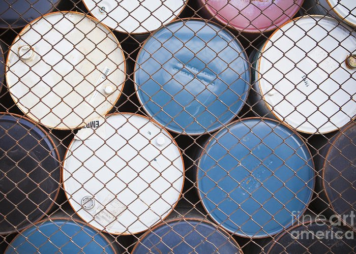 Barrel Greeting Card featuring the photograph Rows Of Stacked Barrels Behind A Fence by Paul Edmondson