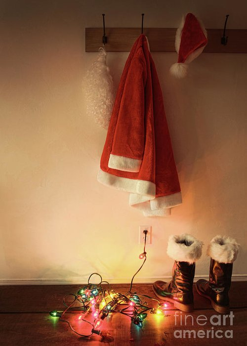 Background Greeting Card featuring the photograph Santa Costume Hanging On Coat Hook With Christmas Lights by Sandra Cunningham