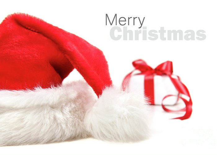 Cap Greeting Card featuring the photograph Santa Hat And Gift With Red Bow by Sandra Cunningham