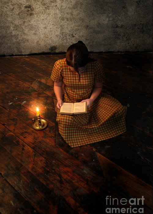 Girl Greeting Card featuring the photograph Schoolgirl Sitting On Wood Floor Reading By Candlelight by Jill Battaglia