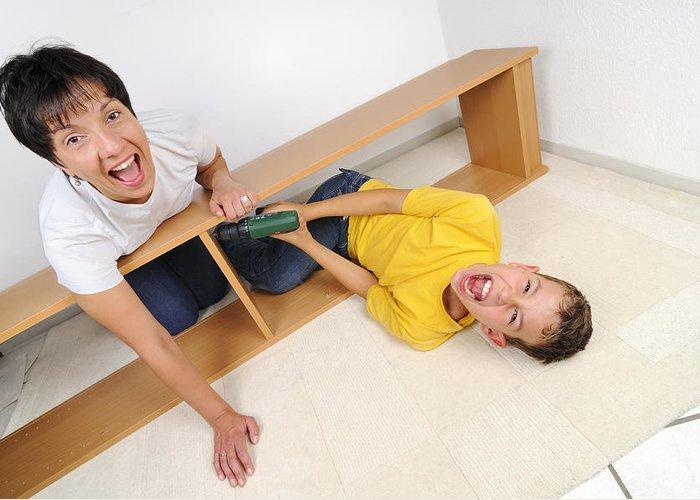 People Greeting Card featuring the photograph Screaming Mother And Son Assembling Furniture by Matthias Hauser