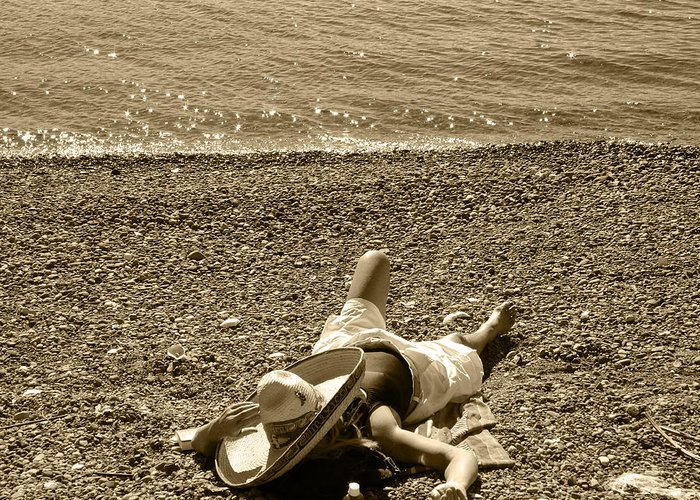 Girl Lays On The Beach With Sombero Hat Greeting Card featuring the photograph She Siestas In The Sun by Kym Backland