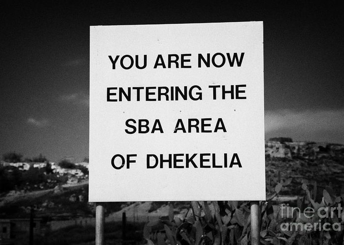 Sba Greeting Card featuring the photograph sign marking entrance of SBA Sovereign Base area of Dhekelia in the british controlled cyprus by Joe Fox
