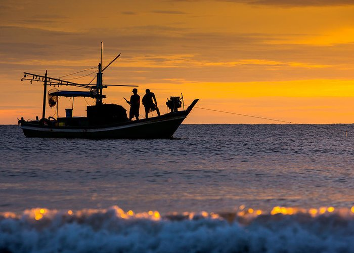Boat Greeting Card featuring the photograph Silhouette Fisherman On Boat In Sunset Huahin by Arthit Somsakul