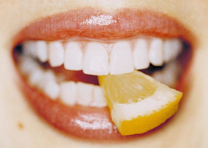 Eating Greeting Card featuring the photograph Slice Of Lemon Between Teeth by Cristina Pedrazzini
