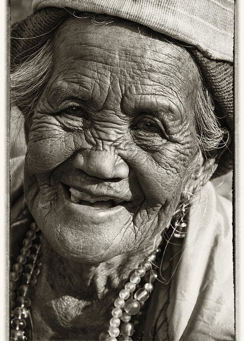 80-90 Yrs; Aborigine; Age; Aging; Art; Asia; Asian; Awe; Banaue; Close-up; Contemplation; Decor; Decoration; Detail; Fine Art; Glisten; Ifugao; Ifugao Province; Indian; Inspirational; Journey; Life; Loneliness; Female; Woman; Memory; Milestone; Native; Old; One; Philippines; Photographic; Photography; Portrait; Reflection; Reverence; Spirituality; Toned; Toned Black And White; Tranquility; Travel Destinations; Tribal; Vertical; Weathered; World Heritage Sight; Worn; Wrinkled; Zen Greeting Card featuring the photograph Smile by Skip Nall