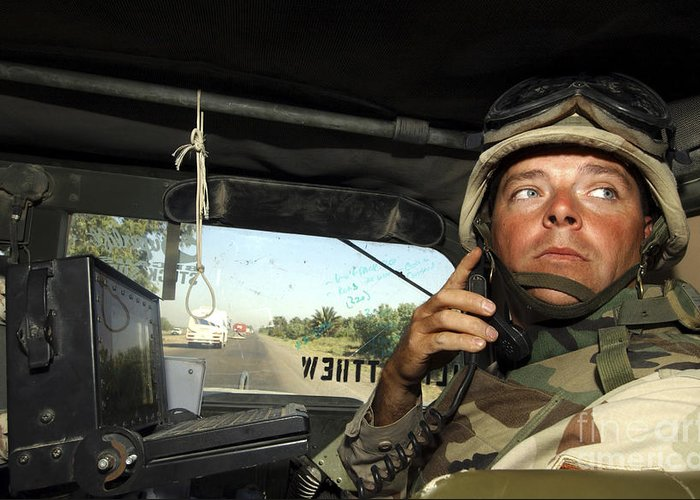 Convoy Greeting Card featuring the photograph Soldier Monitors The Progress Of A 67 by Stocktrek Images