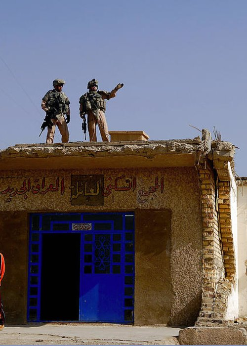 Atop Greeting Card featuring the photograph Soldiers Discuss The New Iraqi Police by Stocktrek Images