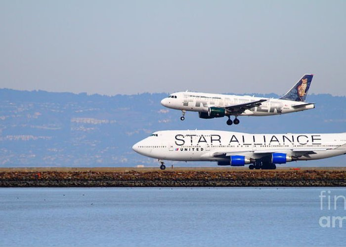 Long Greeting Card featuring the photograph Star Alliance Airlines And Frontier Airlines Jet Airplanes At San Francisco Airport . Long Cut by Wingsdomain Art and Photography