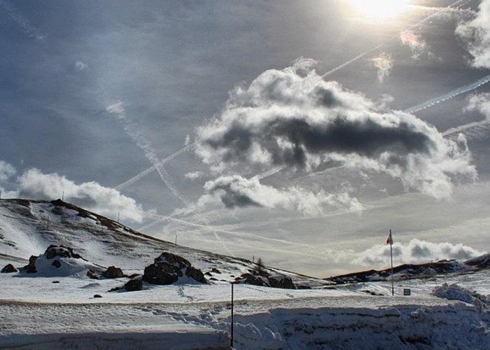 Mountain Greeting Card featuring the photograph Sun, Clouds And Snow by Luisa Azzolini