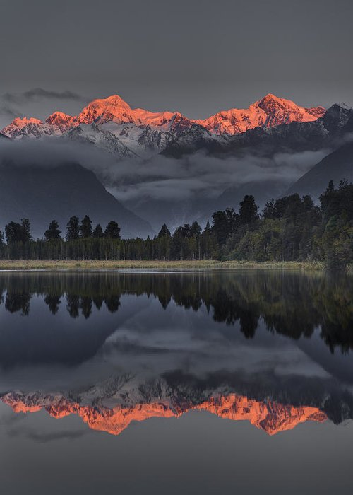 00462453 Greeting Card featuring the photograph Sunset Reflection Of Lake Matheson by Colin Monteath