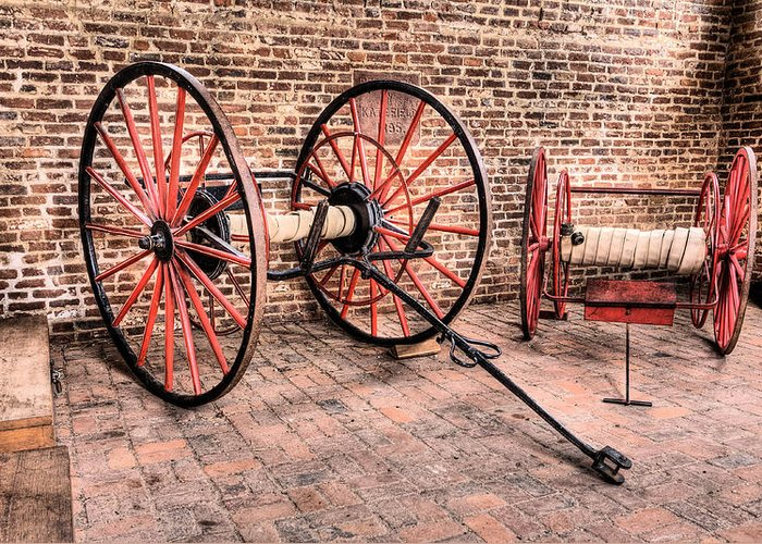Antique Firehouse Fire Station Equipment Firefighting Fire Fightinghose Hoses Wagon 1800s Harpers Ferry West Virginia Wv Historic History Greeting Card featuring the photograph The Firehouse by JC Findley