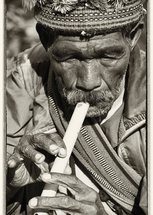80-90 Yrs; Aborigine; Age; Aging; Art; Asia; Asian; Awe; Banaue; Close-up; Contemplation; Decor; Decoration; Detail; Fine Art; Glisten; Ifugao; Ifugao Province; Indian; Inspirational; Journey; Life; Loneliness; Male; Man; Memory; Milestone; Native; Old; One; Philippines; Photographic; Photography; Portrait; Reflection; Reverence; Spirituality; Toned; Toned Black And White; Tranquility; Travel Destinations; Tribal; Vertical; Weathered; World Heritage Sight; Worn; Wrinkled; Zen Greeting Card featuring the photograph The Flute by Skip Nall
