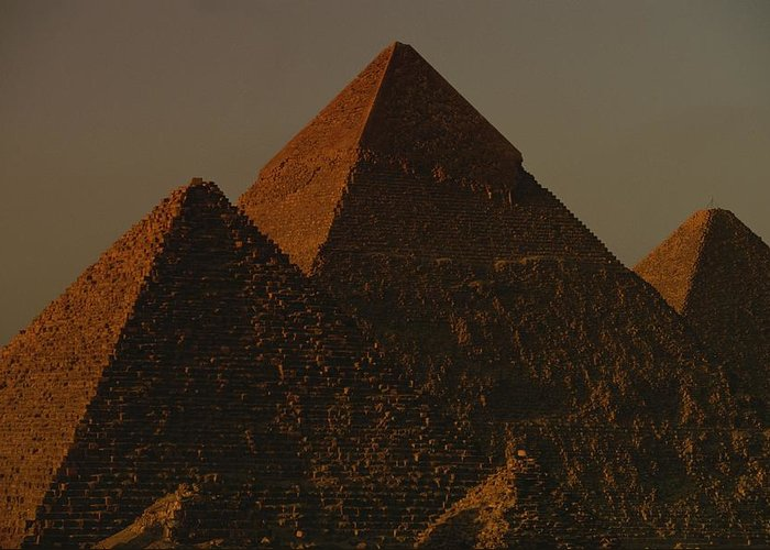 Africa Greeting Card featuring the photograph The Pyramids Of Giza In The Late by Kenneth Garrett
