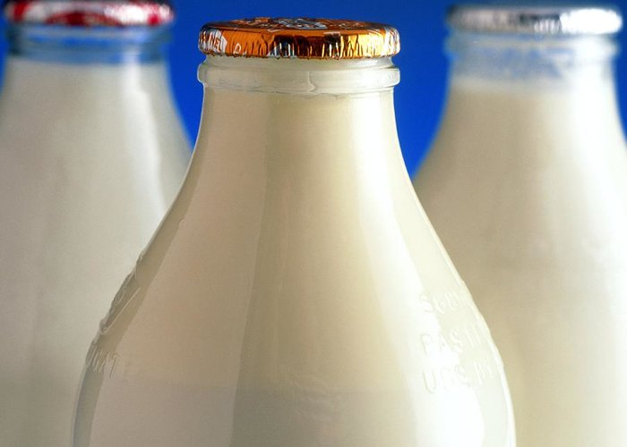 Milk Greeting Card featuring the photograph Tops Of Three Types Of Bottled Milk by Steve Horrell