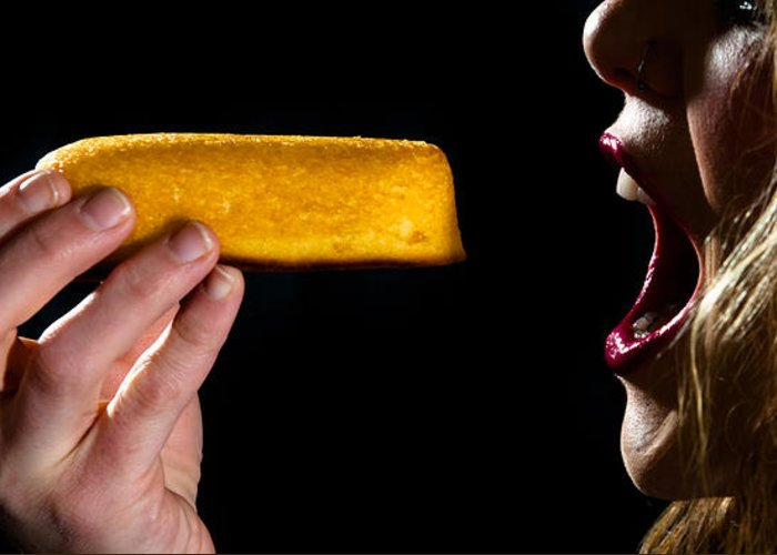Twinkie Greeting Card featuring the photograph Twinkie Bite by Scott Sawyer