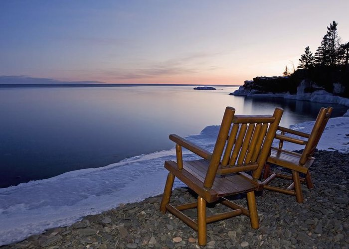 Sunset Greeting Card featuring the photograph Two Chairs At Waters Edge Looking Out by Susan Dykstra