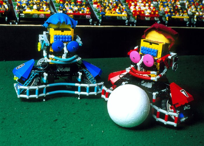 Robot Football Greeting Card featuring the photograph Two Lego Footballers With A Ball At Robocup-98 by Volker Steger