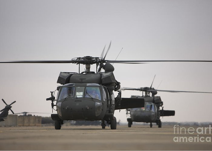 Aviation Greeting Card featuring the photograph Two Uh-60 Black Hawks Taxi by Terry Moore