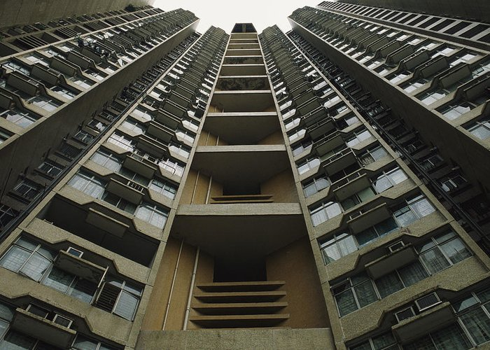 Scenes And Views Greeting Card featuring the photograph Upward View Of A Public Housing by Justin Guariglia