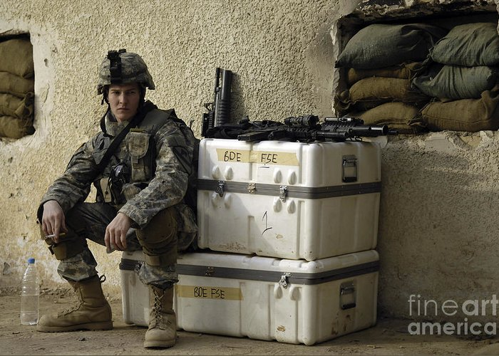 Operation Iraqi Freedom Greeting Card featuring the photograph U.s. Army Soldier Relaxing Before Going by Stocktrek Images