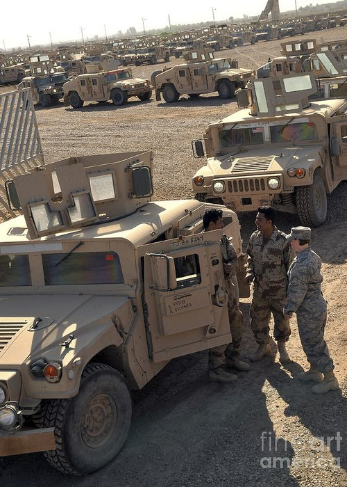 M1114 Greeting Card featuring the photograph U.s. Army Soldier Speaks With Iraqi by Stocktrek Images