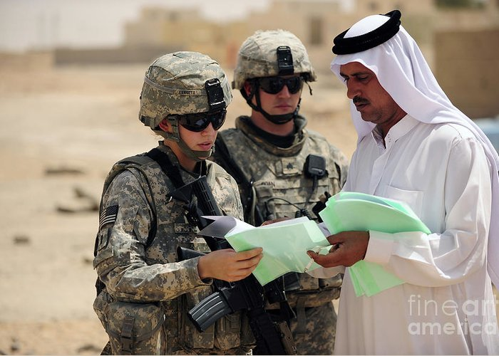 Operation Iraqi Freedom Greeting Card featuring the photograph U.s. Army Soldiers Talking With A Town by Stocktrek Images