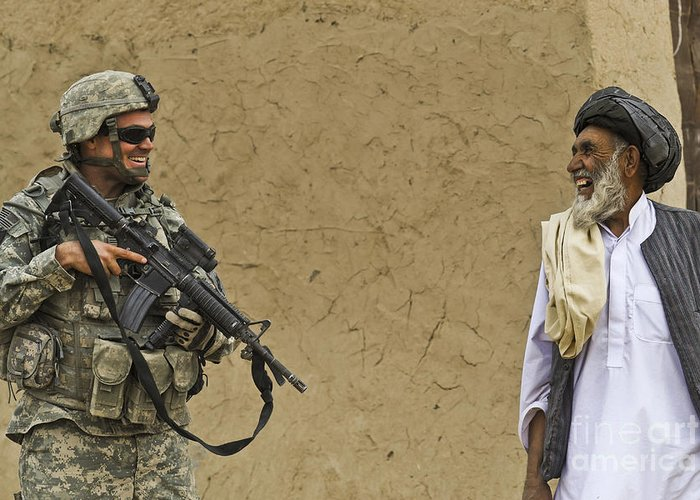 Afghan National Army Greeting Card featuring the photograph U.s. Army Specialist Talks To An Afghan by Stocktrek Images