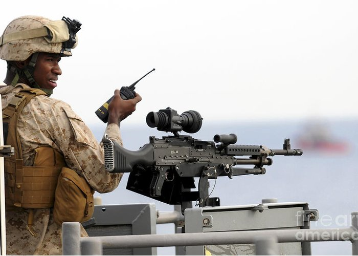 Surveillance Greeting Card featuring the photograph U.s. Marine Talks On A Radio While by Stocktrek Images