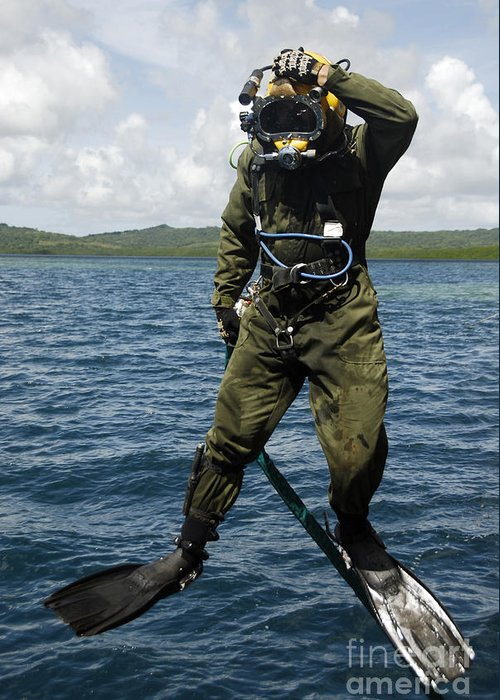 Adults Only Greeting Card featuring the photograph U.s. Navy Diver Jumps Off A Dive by Stocktrek Images