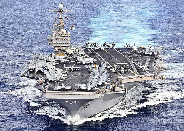 Warship Greeting Card featuring the photograph Uss Abraham Lincoln Transits by Stocktrek Images