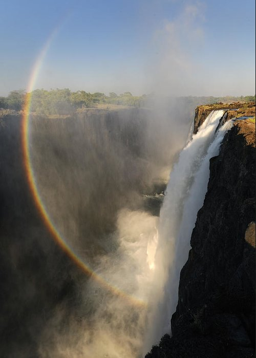 Rainbow At The Victoria Falls Greeting Card featuring the photograph Victoria Falls by Christian Heeb