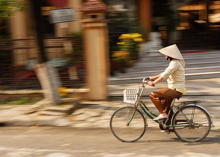 Cycling Greeting Card featuring the photograph Vietnamese Woman Riding A Bicycle by Panya Jampatong
