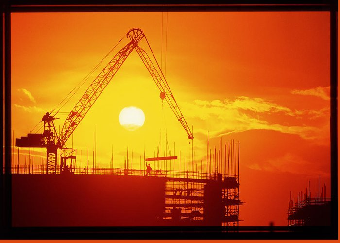 Crane Greeting Card featuring the photograph View Of A Construction Site At Sunset by Jeremy Walker