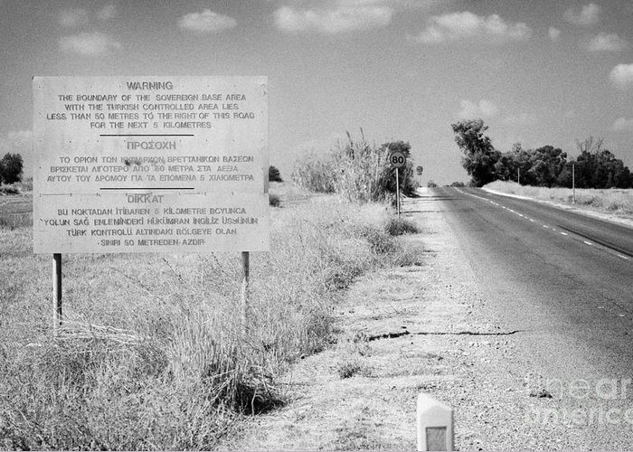 Sba Greeting Card featuring the photograph warning road sign warning of the border of the turkish military controlled area of the SBA Sovereign by Joe Fox
