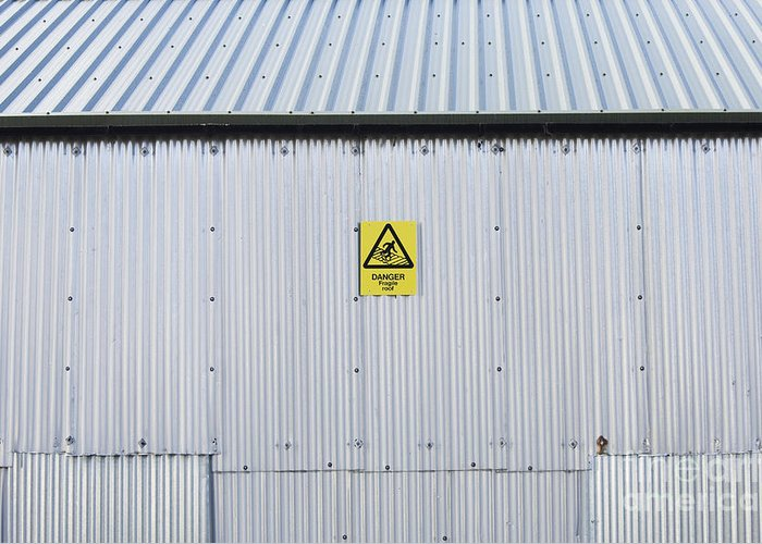 Architecture Greeting Card featuring the photograph Warning Sign On An Industrial Building by Iain Sarjeant