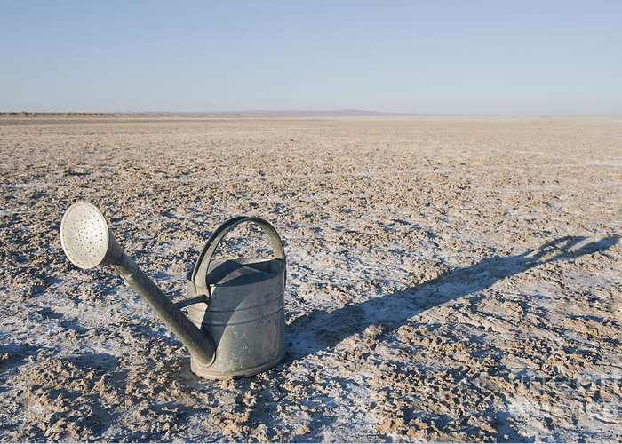 Arc Greeting Card featuring the photograph Water Pail On Dried Mud by Thom Gourley/Flatbread Images, LLC