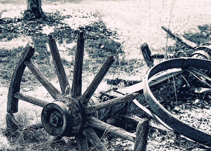 Wagon Wheel Greeting Card featuring the photograph Weathered Wagon Wheel Broken Down by Tracie Kaska