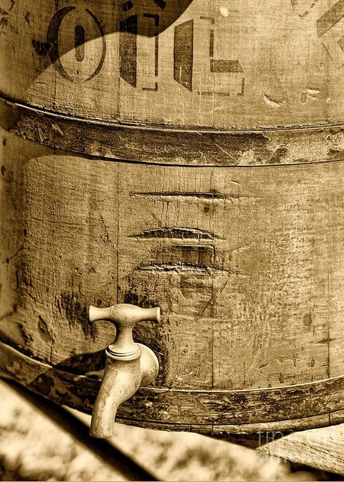 Weathered Red Oil Bucket Greeting Card featuring the photograph Weathered Wooden Bucket In Sepia by Paul Ward