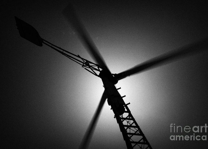Sun Greeting Card featuring the photograph Wind Turbine Blades Spinning by Joe Fox
