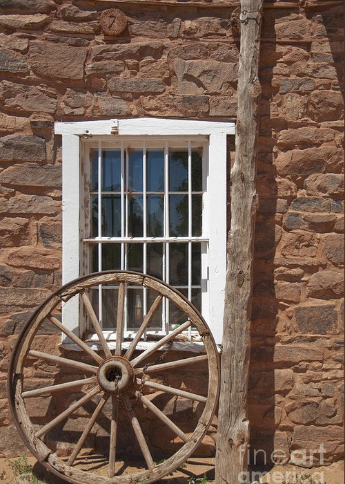 Ancient Greeting Card featuring the photograph Window In Stone Building With Wagon Wheel by Thom Gourley/Flatbread Images, LLC