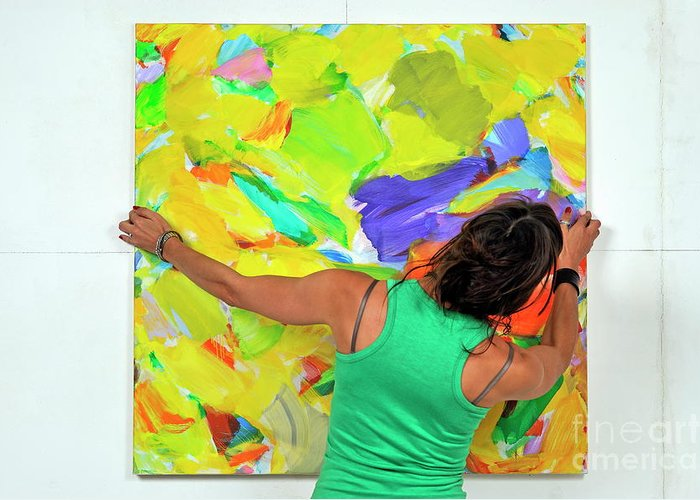 Art Product Greeting Card featuring the photograph Woman Adjusting A Painting by Sami Sarkis