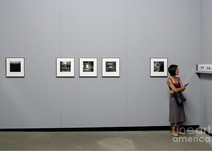 Casual Clothing Greeting Card featuring the photograph Woman Watching Photos At Exhibition by Sami Sarkis