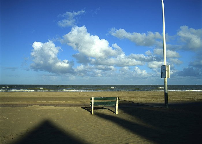 Outdoors Greeting Card featuring the photograph Wooden Bench In Front Of Ocean.deauville. France by Bernard Jaubert