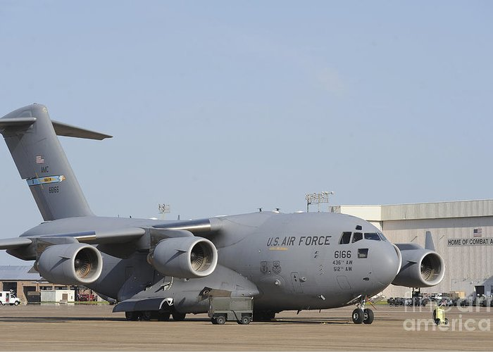 Military Greeting Card featuring the photograph A C-17 Globemaster IIi Parked by Stocktrek Images