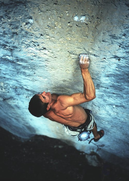 Adventure Greeting Card featuring the photograph A Caucasian Man Rock Climbing by Bobby Model